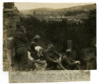 Photograph of 165th Infantry, 42nd Division soldiers overlooking Baccarat, France with a French...