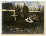 Photograph of Ruby Garrett standing next to the grave of William P. Borland in France
